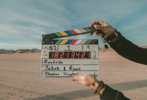 A clapperboard in the desert marking the beginning of a scene