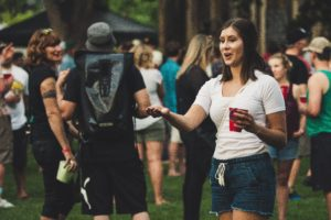 People talking and drinking outdoors. Best music festivals in America.