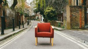 A red chair on the street.