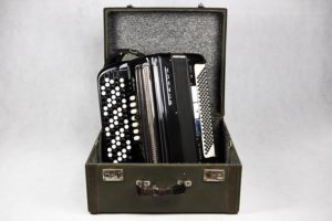 an accordion in an original case to protect your musical instruments
