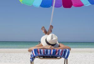 A man relaxing on a Florida beach.