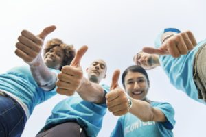 a group of people showing their thumbs up because they are the right moving assistance option for you