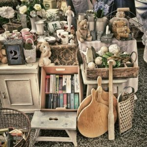 A flea market stall, with various items.