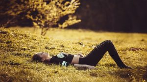 Girl lying on a field of grass.