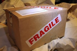"A box, with ""fragile"" label."