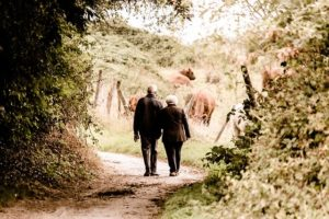 A couple walking on trail because they're living in Hollywood after retirement.