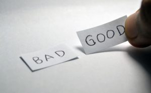 Two pieces of paper with the words good and bad.