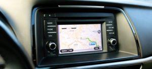 A GPS navigator inside a car thanks to modern transportation technology.