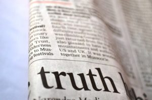 """Word """"truth"""" written in newspapers."""
