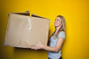 A girl holding a used box
