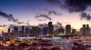 The Miami skyline at night, representing moving from California to Florida