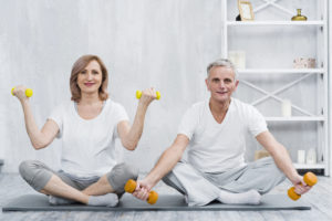 picture showing two seniors exercising as one of activities for retirees