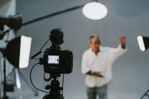 A man at a filming studio.