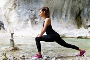 Young woman warming up and thinking about hobbies that will help you stay in shape.