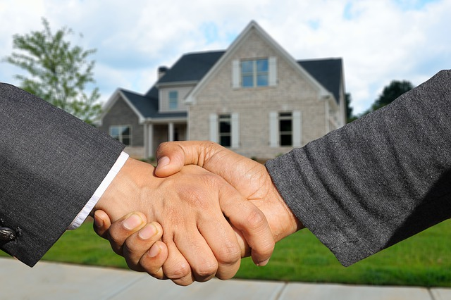 Shake hands after buying your first rental property in Hollywood.
