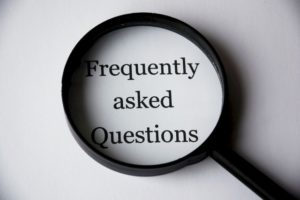 """There is a close up inscription saying """"Frequently asked Questions"""", something you can find on every web page if you search for movers online."""