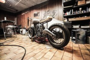 A motorcycle in a garage before you prepare your motorcycle for a move.