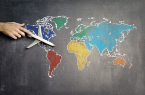 There is a small toy plane on a world map as making international connections is one of the main benefits of expanding your Seattle business to LA.