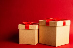 There are two cardboard boxes packed to look like presents, a great and useful idea for leftover moving boxes.
