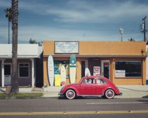 VW Red Beetle on the road in Californians' favorite East Coast city.