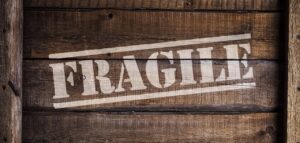 Fragile sign on a wooden crate.