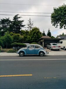 A car in a street of Palo Alto, one of the small towns in California to consider when starting a business.