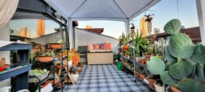 A balcony with seating with built-in storage. That's one of the ways you can make more storage space on your balcony.