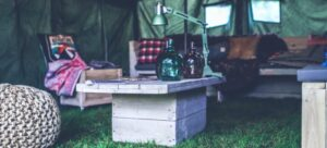 A wooden table and other things on the grass