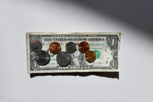 A dollar banknote and some coins.