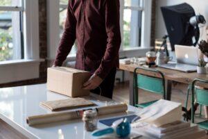 A man doing his best to prepare memorabilia for storage.
