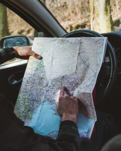 A man in a car looking at a map